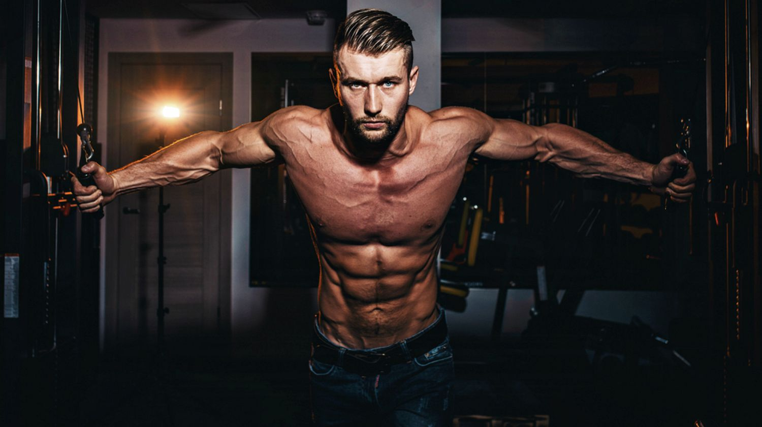 Feature | Man pumping up muscle | Your Ultimate Guide To Estrogen Blockers