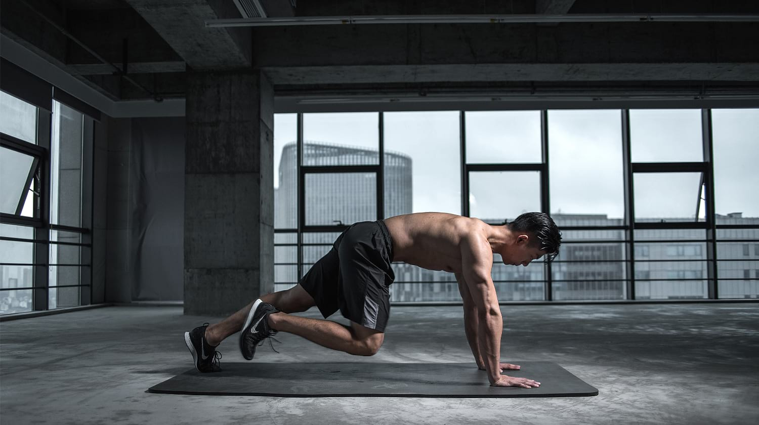 man working out alone | Nootropics: Benefits And Why Athletes Are Adding Them To Their Stack | featured